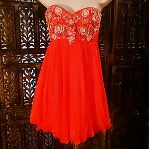 Pinkish/orange looking dress w/ Rhinestone, size 1